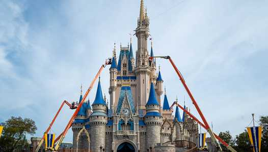 PHOTOS - Cinderella Castle's new paint scheme begins to take shape at the Magic Kingdom