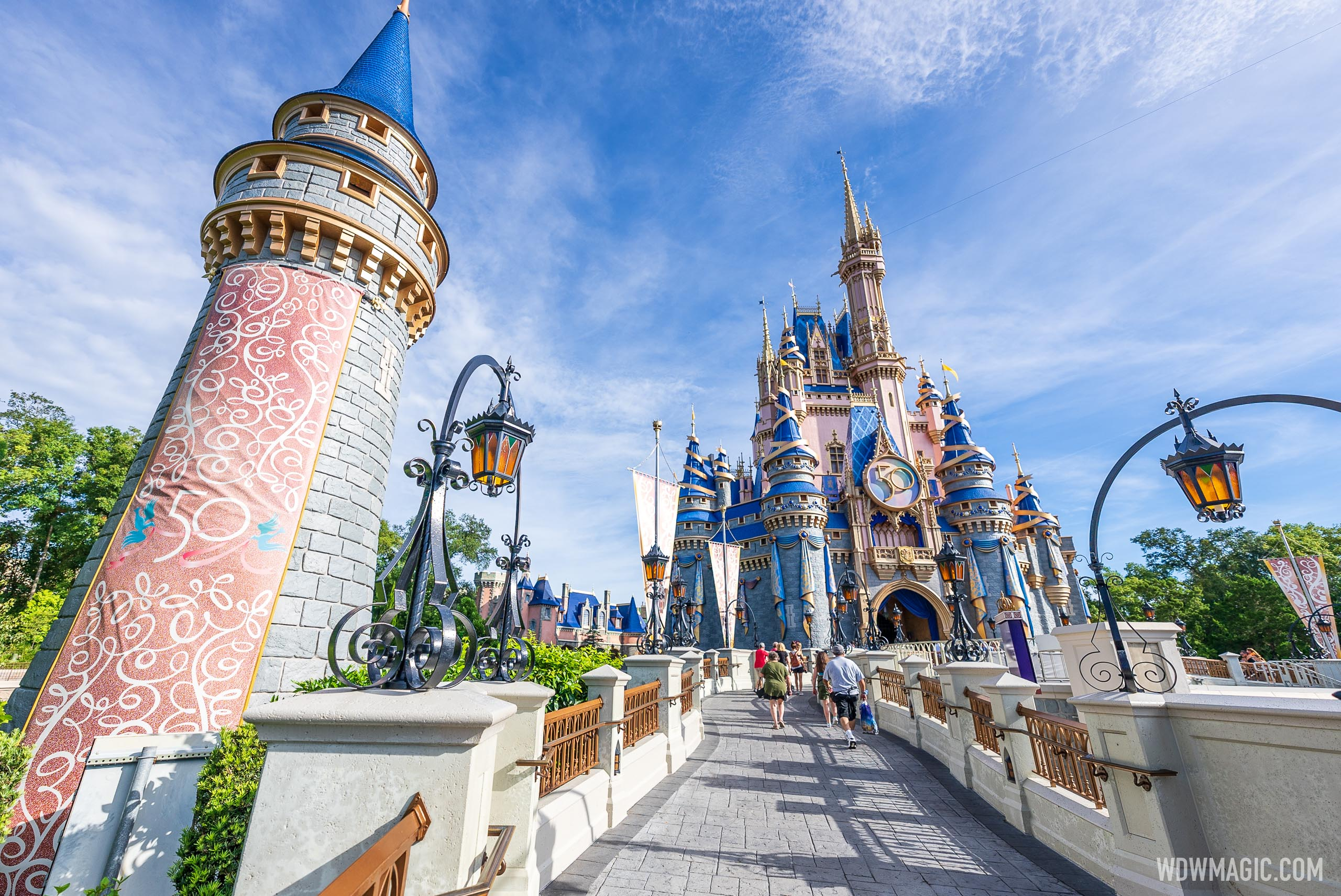 New 50th anniversary banners added to Cinderella Castle at Magic Kingdom