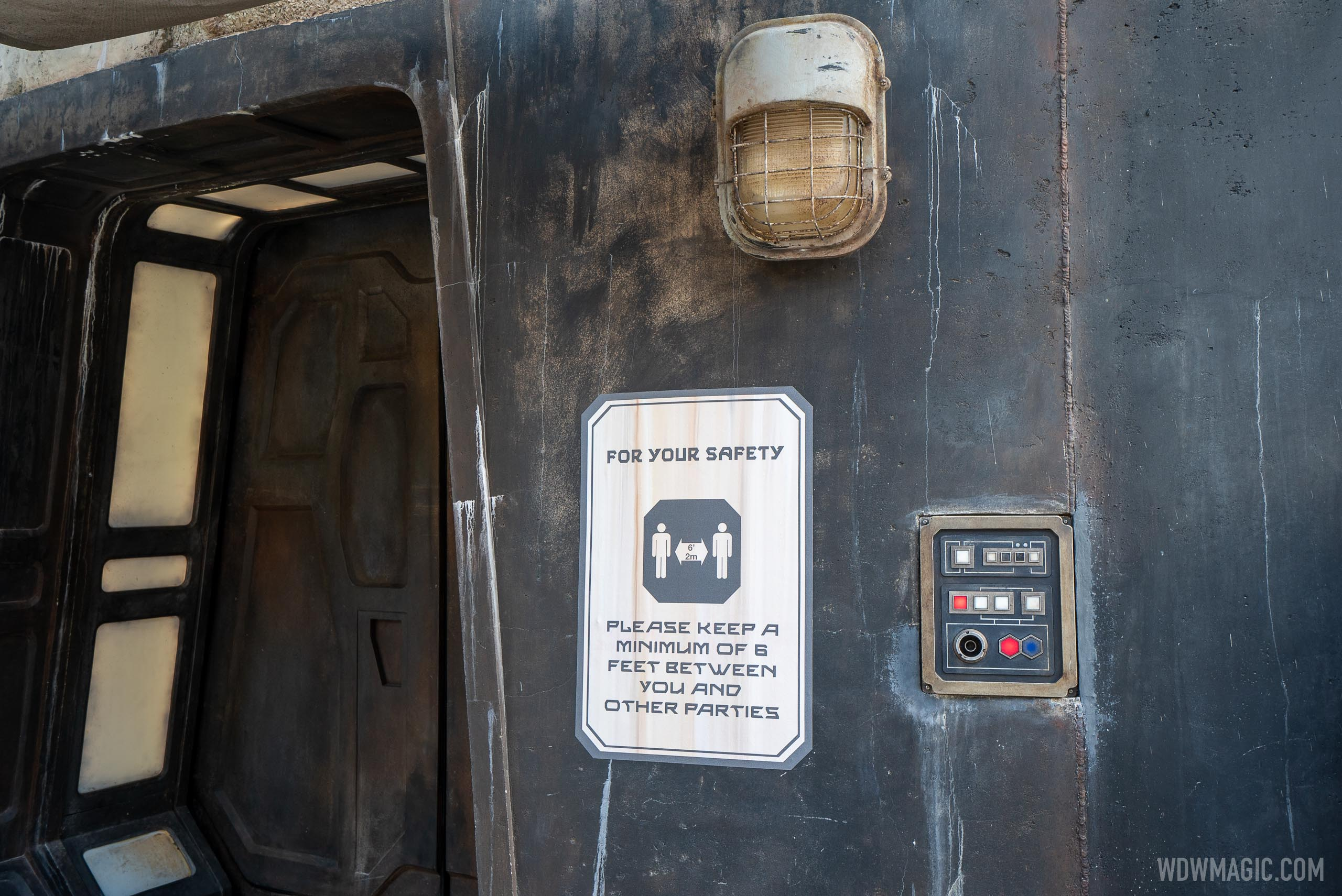 Themed physical distancing safety signs in Galaxy's Edge