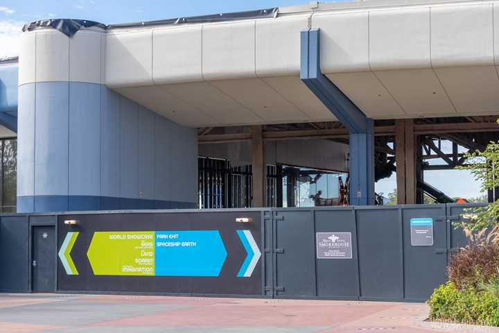 PHOTOS - More glass panels installed along the former Future World east breezeway