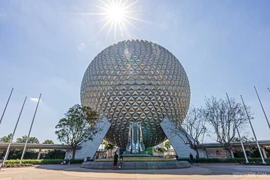 PHOTOS - Western side flag poles installed beside Spaceship Earth as main entrance improvements continue