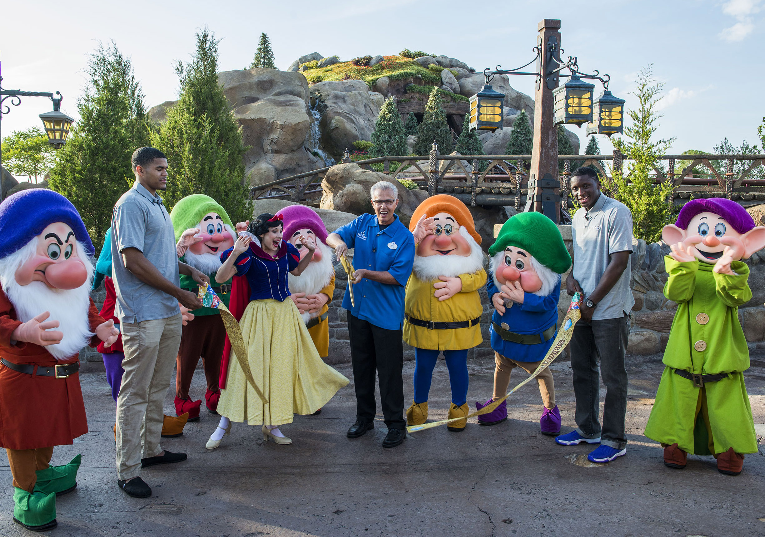 Phil Holmes (center), vice president of Magic Kingdom Park seen at the opening of Seven Dwarfs Mine Train