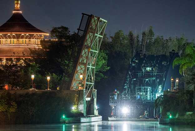 Harmonious show platform barge passing through the bridge into World Showcase Lagoon