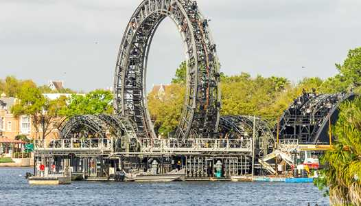 PHOTOS - EPCOT'S Harmonious central icon barge receives third and final platform
