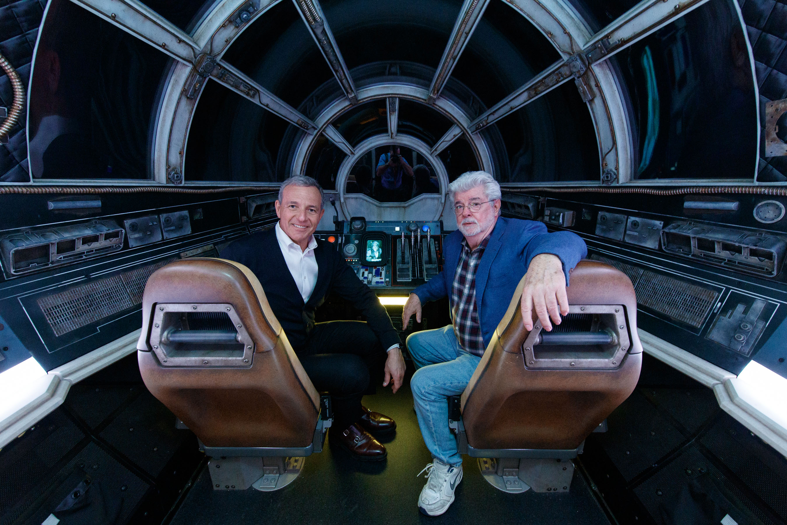 Bob Iger, Walt Disney Company Chairman and CEO (left), and George Lucas, Star Wars creator, pose inside Millennium Falcon: Smugglers Run