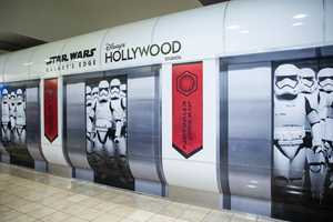 PHOTOS - Travelers arriving at Orlando International Airport get a glimpse of Star Wars Galaxy's Edge