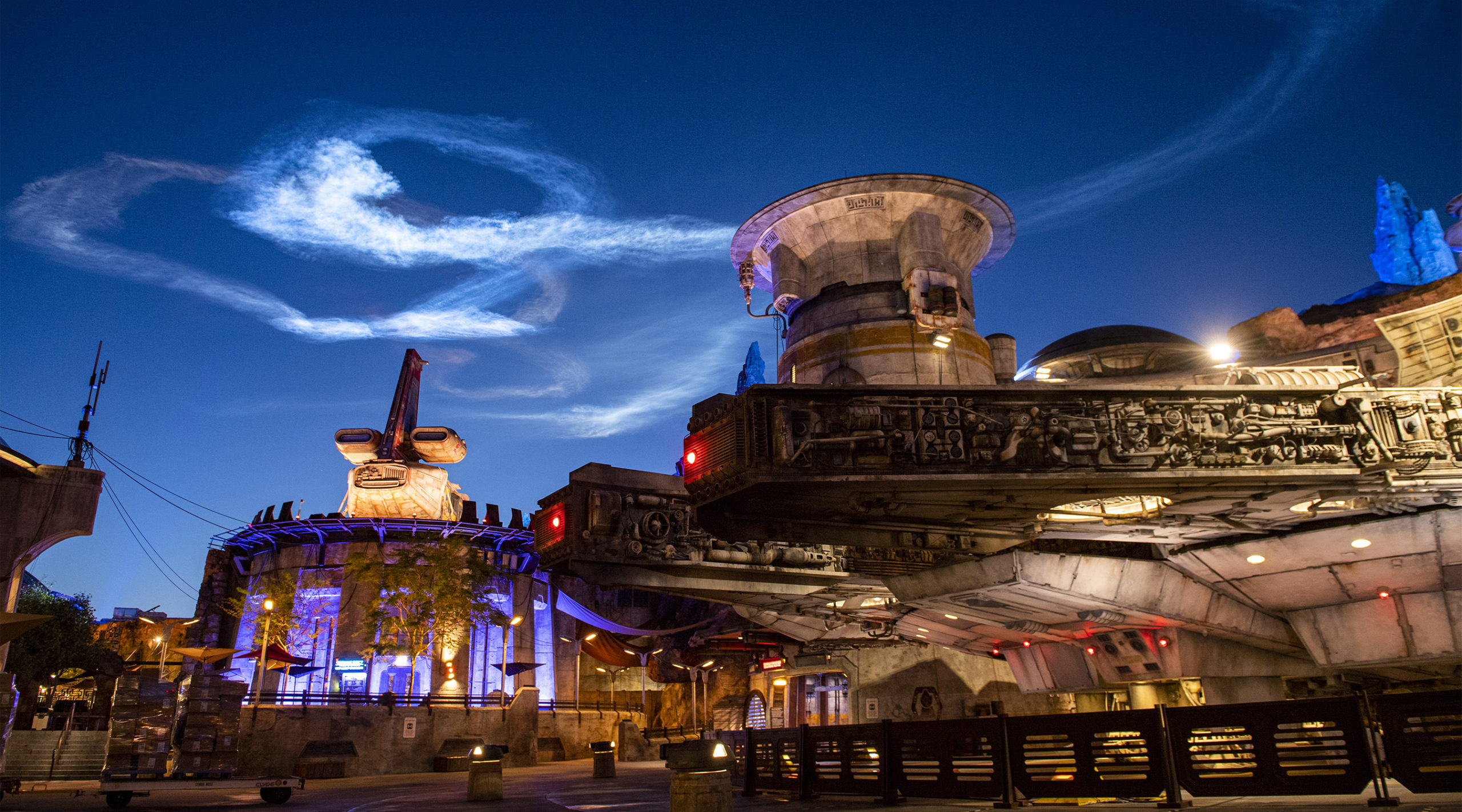 SpaceX's Falcon 9 rocketlLaunch over Star Wars Galaxy's Edge and Space Mountain