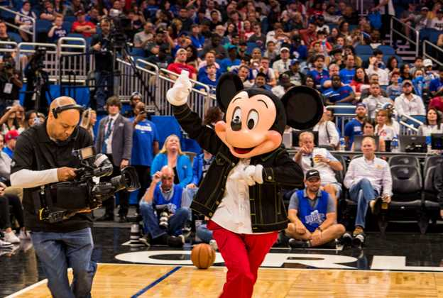Mickey Mouse appears on court to announce the opening of The NBA Experience