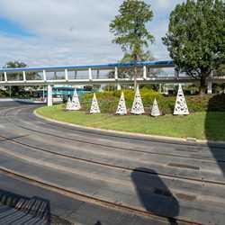 Tomorrowland Speedway Christmas light overlay daytime