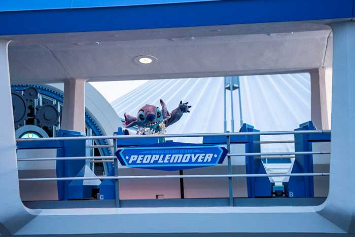 Stitch rides the Tommorowland Transit Authority PeopleMover