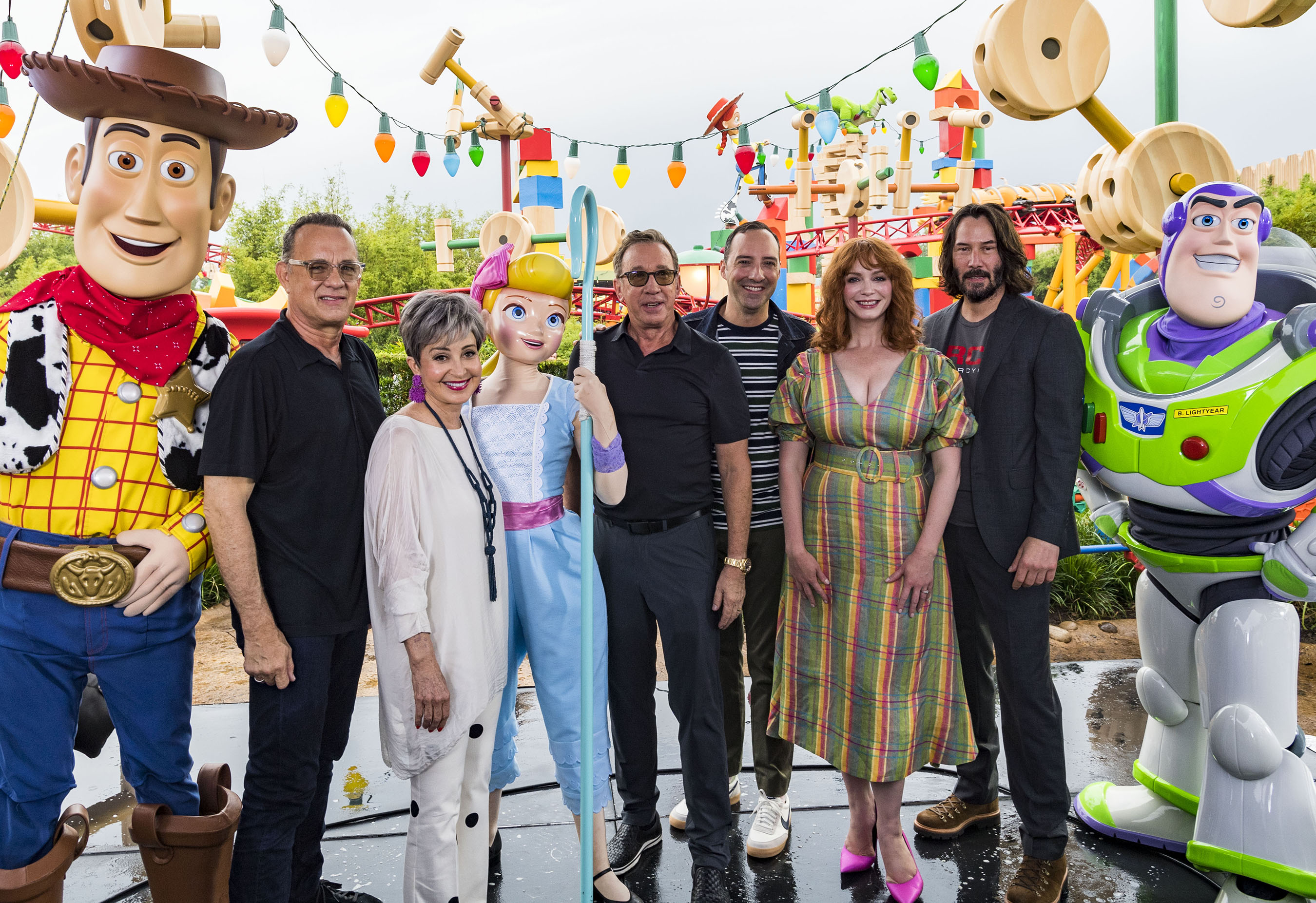 "Stars from Disney•Pixar's ""Toy Story 4"" appear with characters from the film inside Toy Story Land at Disney's Hollywood Studios at Walt Disney World Resort in Lake Buena Vista, Fla., June 8, 2019. From left: Woody, Tom Hanks, Annie Potts, Bo Peep, Tim Allen, Tony Hale, Christina Hendricks, Keanu Reeves and Buzz Lightyear. (Matt Stroshane, photographer)"
