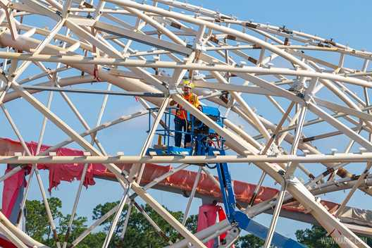 Lighting systems being installed in the canopy at TRON Lightcyle Run