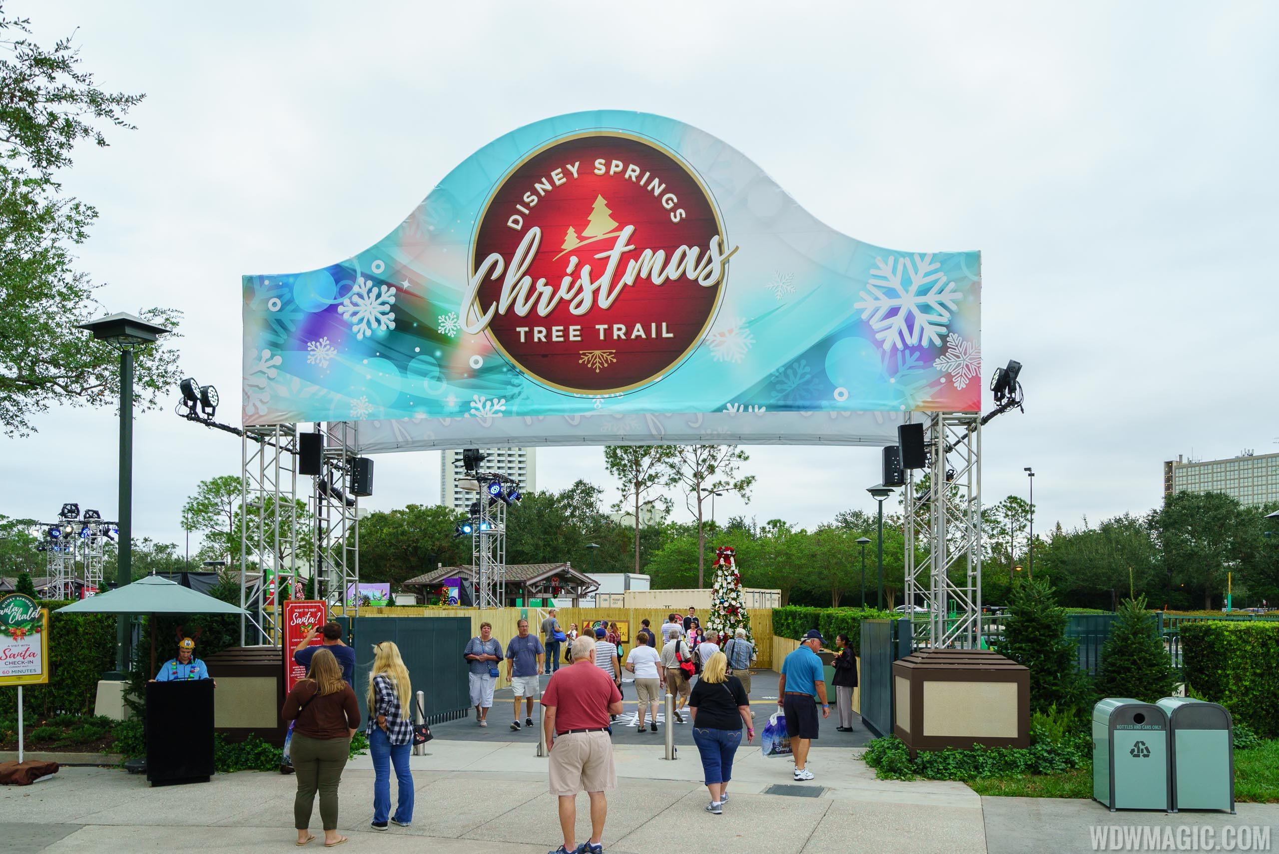 photos disney springs expanded christmas tree trail and new location for santas chalet