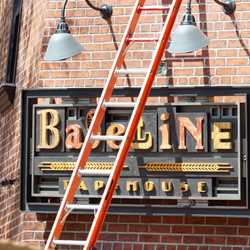 Signage installation at Baseline Tap House and Grand Avenue