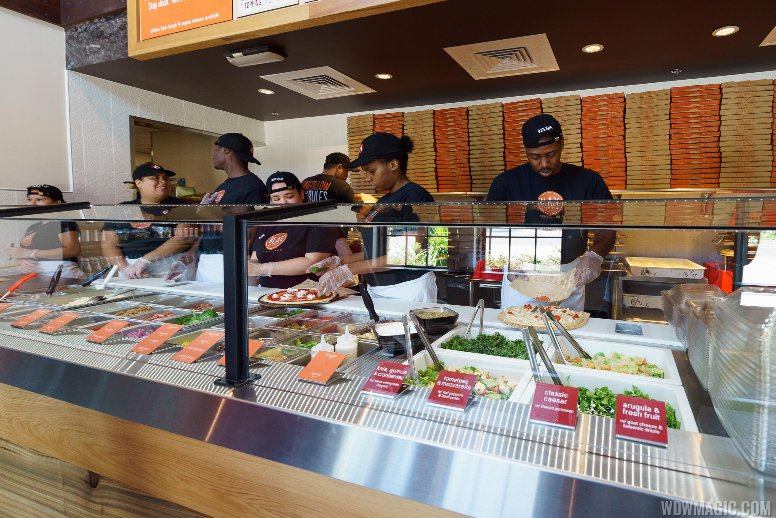 Disney Springs Blaze Pizza assembly line