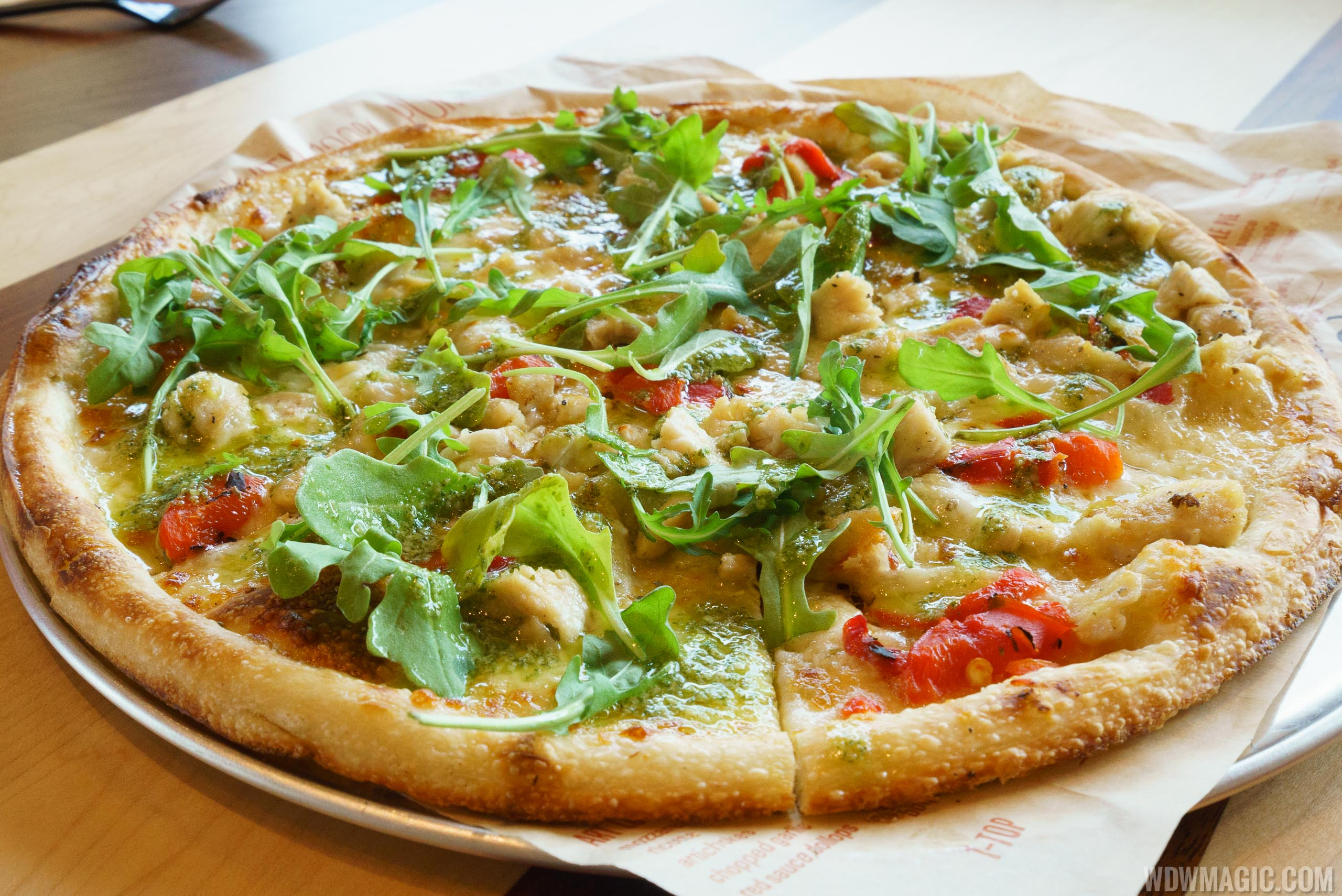 Blaze Pizza - Green Stripe signature pizza - Pesto Drizzle over Chicken, Red Peppers, Garlic, Mozzarella and Arugula