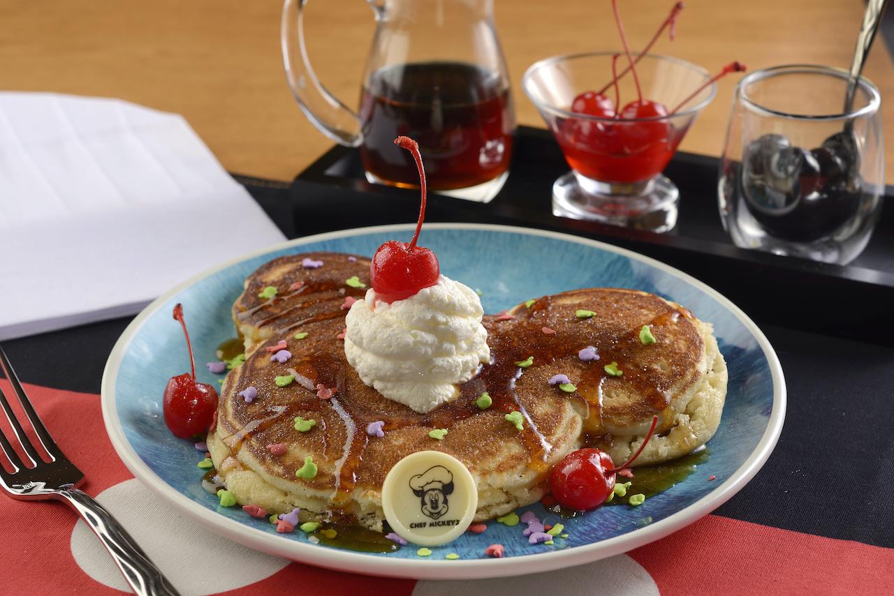 "Mickey's ""Celebration"" Pancake, featuring whipped cream, celebration sprinkles"