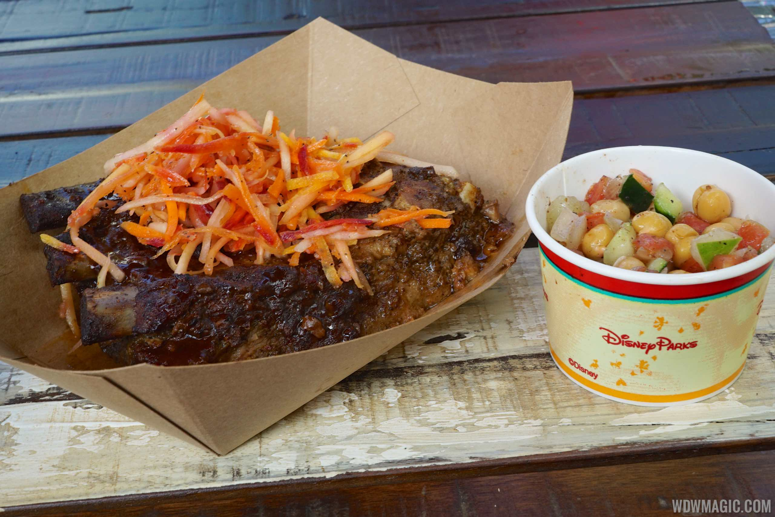 Harambe Market Food - Spice-rubbed Karubi Ribs with green papaya-carrot slaw and a chickpea cucumber and tomato salad $13.39