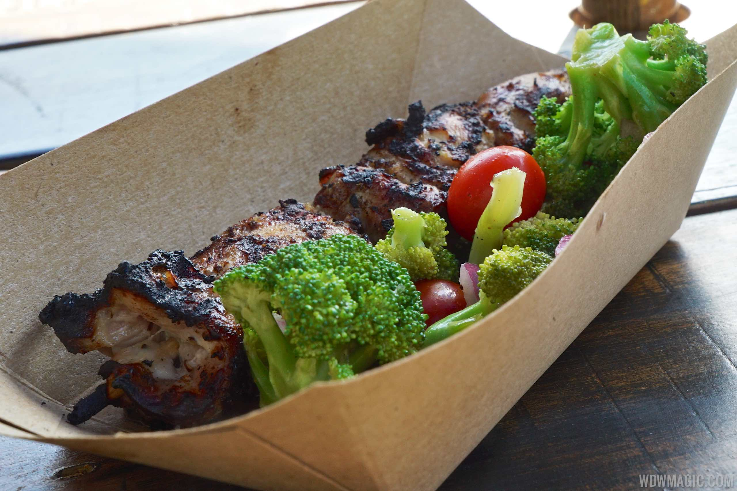 Harambe Market Food - Chicken Skewer with broccoli and tomato salad $8.99