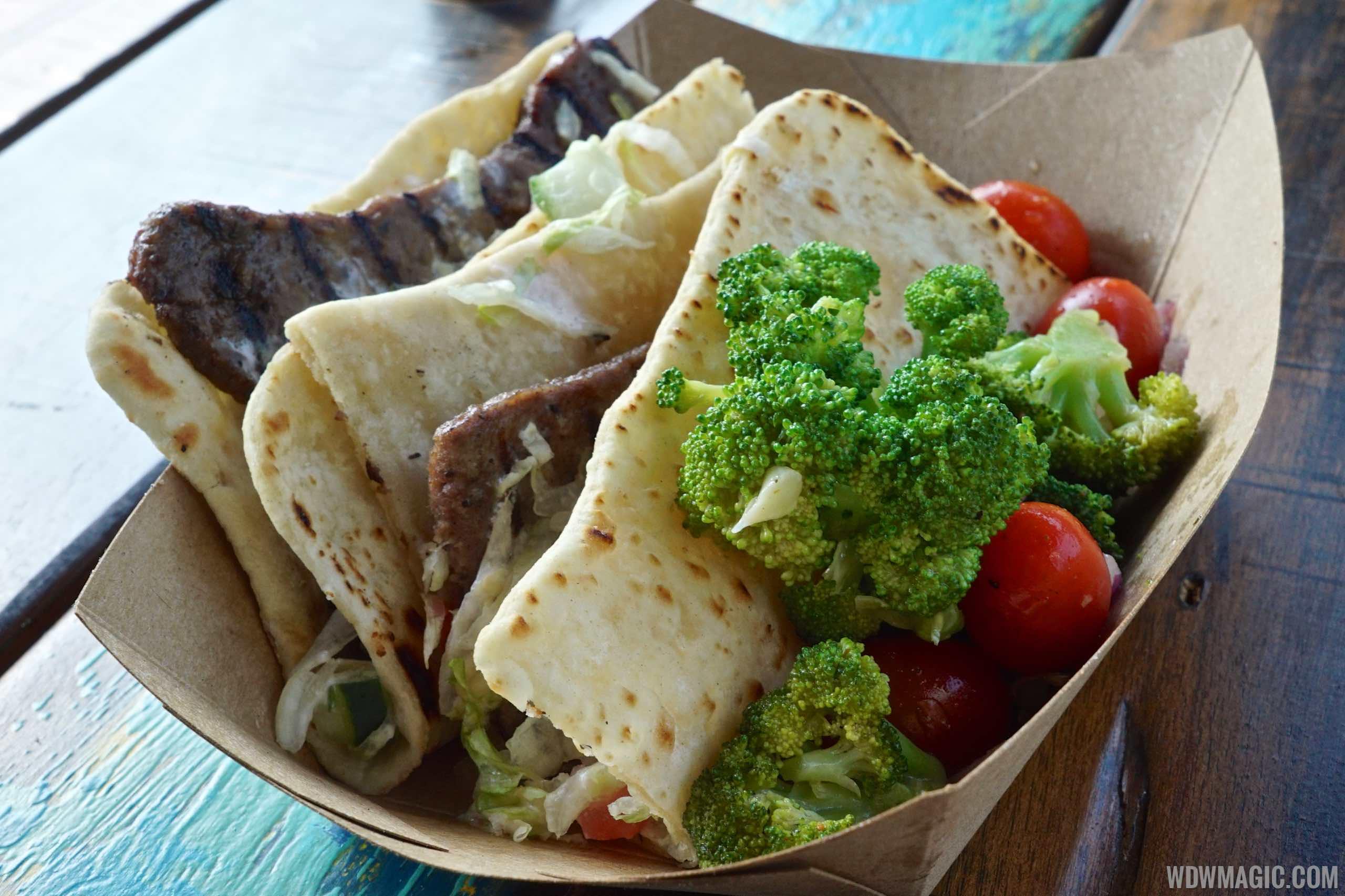 Harambe Market Food - Ground Beef Kabob Flatbread with broccoli and tomato salad $9.49