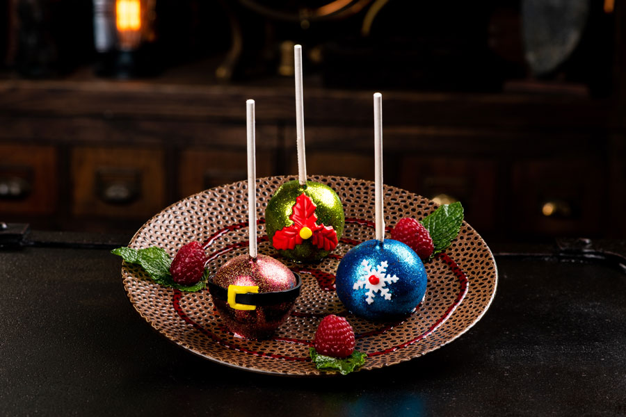 Jingle Bell Pops: Three dark chocolate truffles, crushed peppermint and peppermint syrup dipped in dark chocolate.
