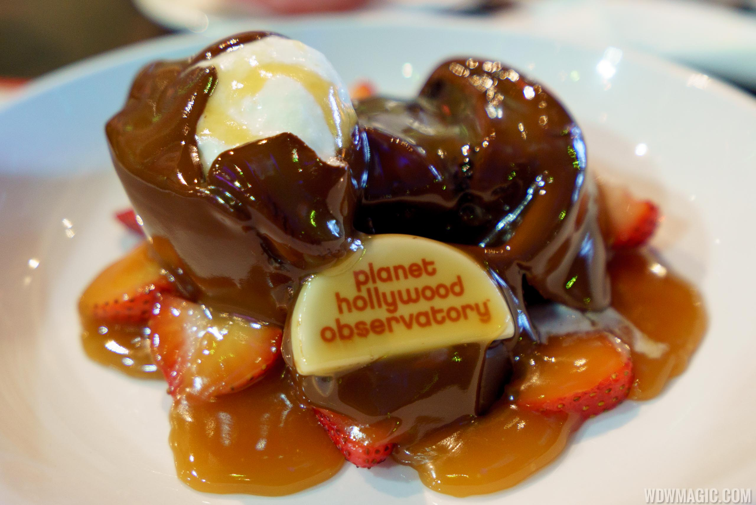 Planet Meltdown - $14.99 Chocolate sphere melted tableside by hot chocolate sauce to reveal double chocolate fudge cake, fresh strawberries and whipped cream