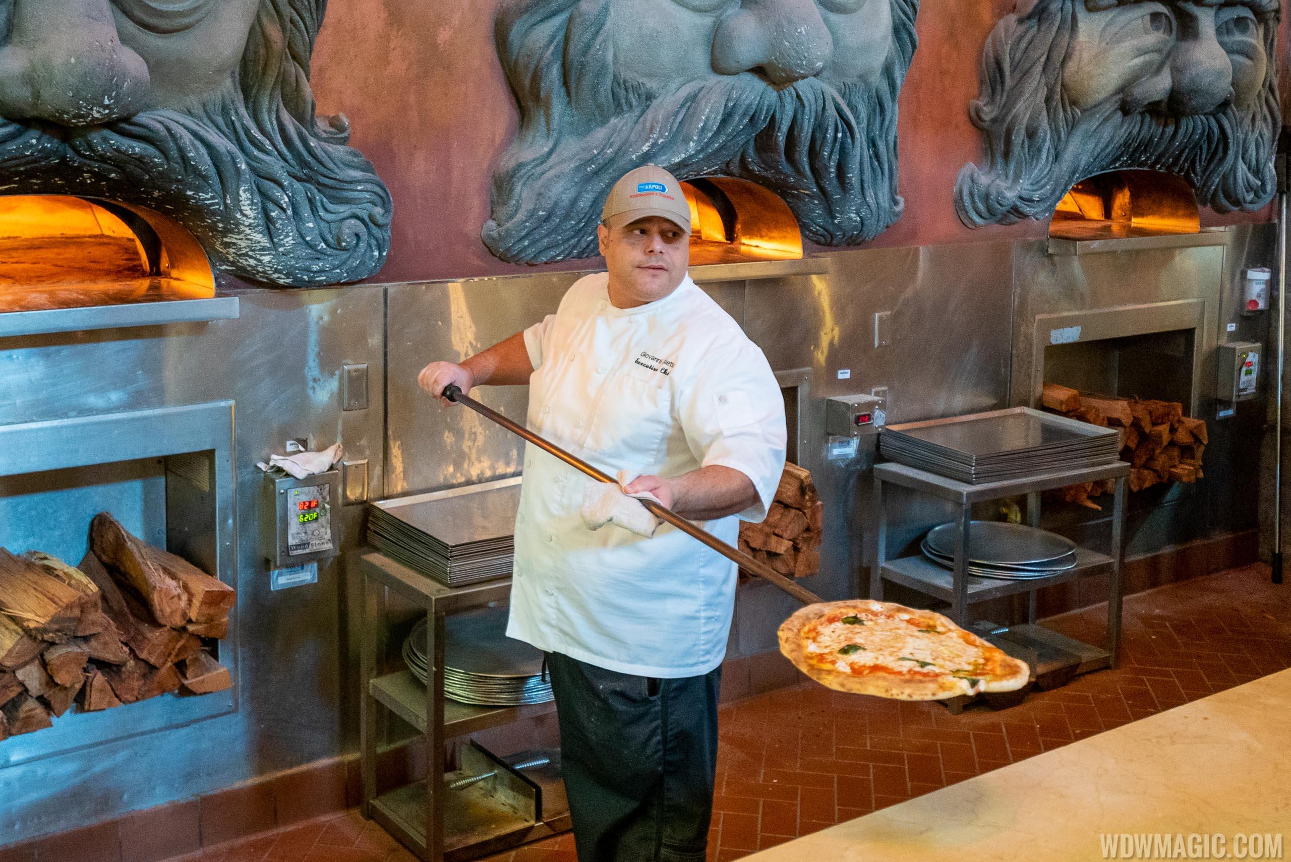 Via Napoli Executive Chef Giovanni Aletto displays the perfect pizza fresh from the oven