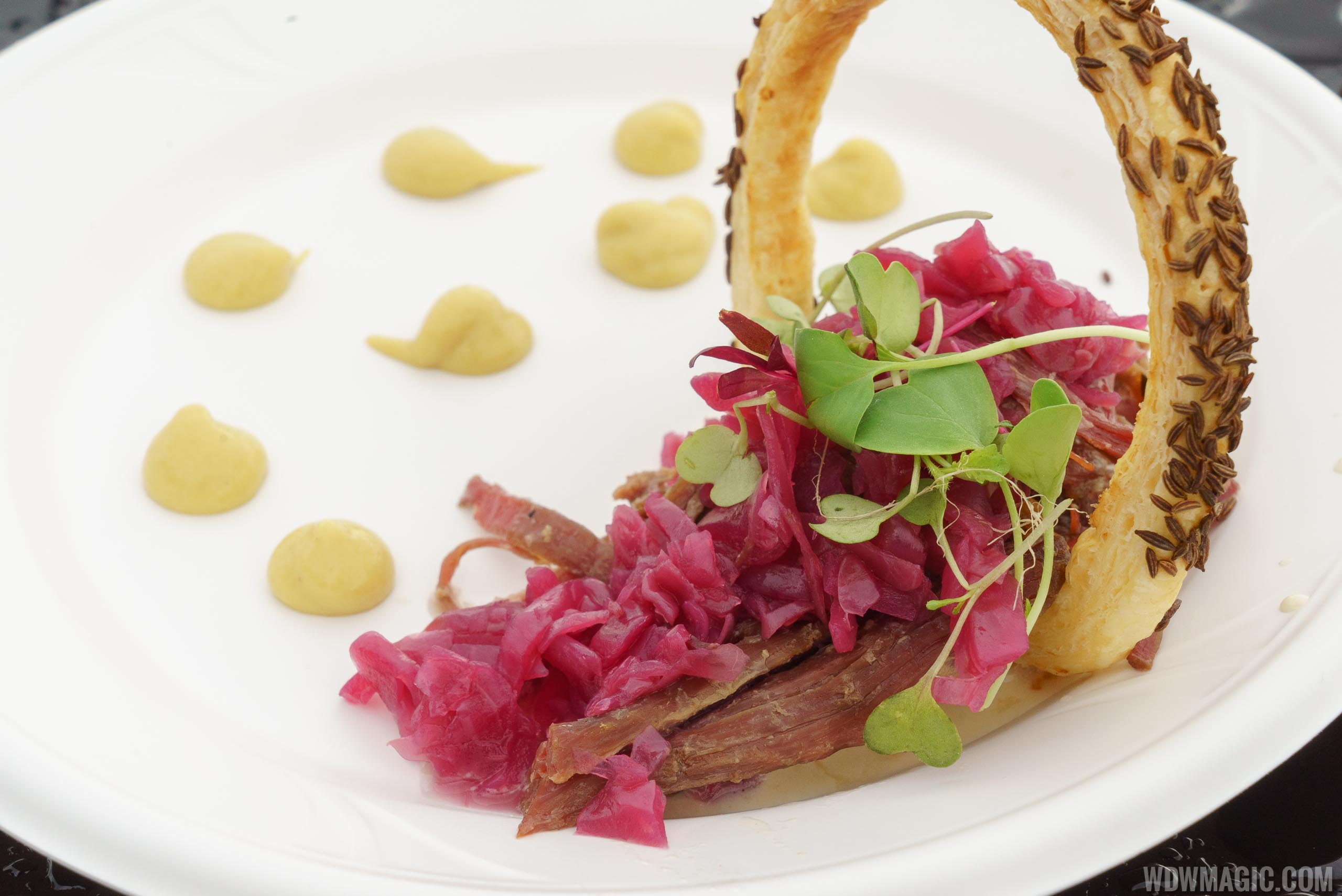 Festival of the Arts Food Studio - E = AT^2 -Classic Reuben with Shredded Corned Beef, Thousand Island Dressing, Pickled Red Cabbage and a Rye Curl