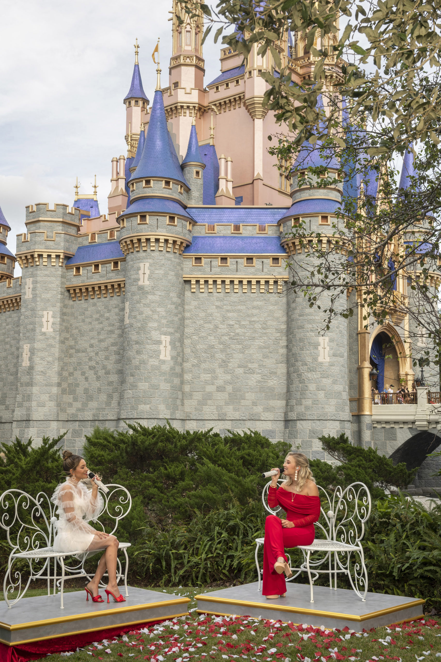 Country duo Maddie & Tae perform in front of Cinderella Castle at Magic Kingdom
