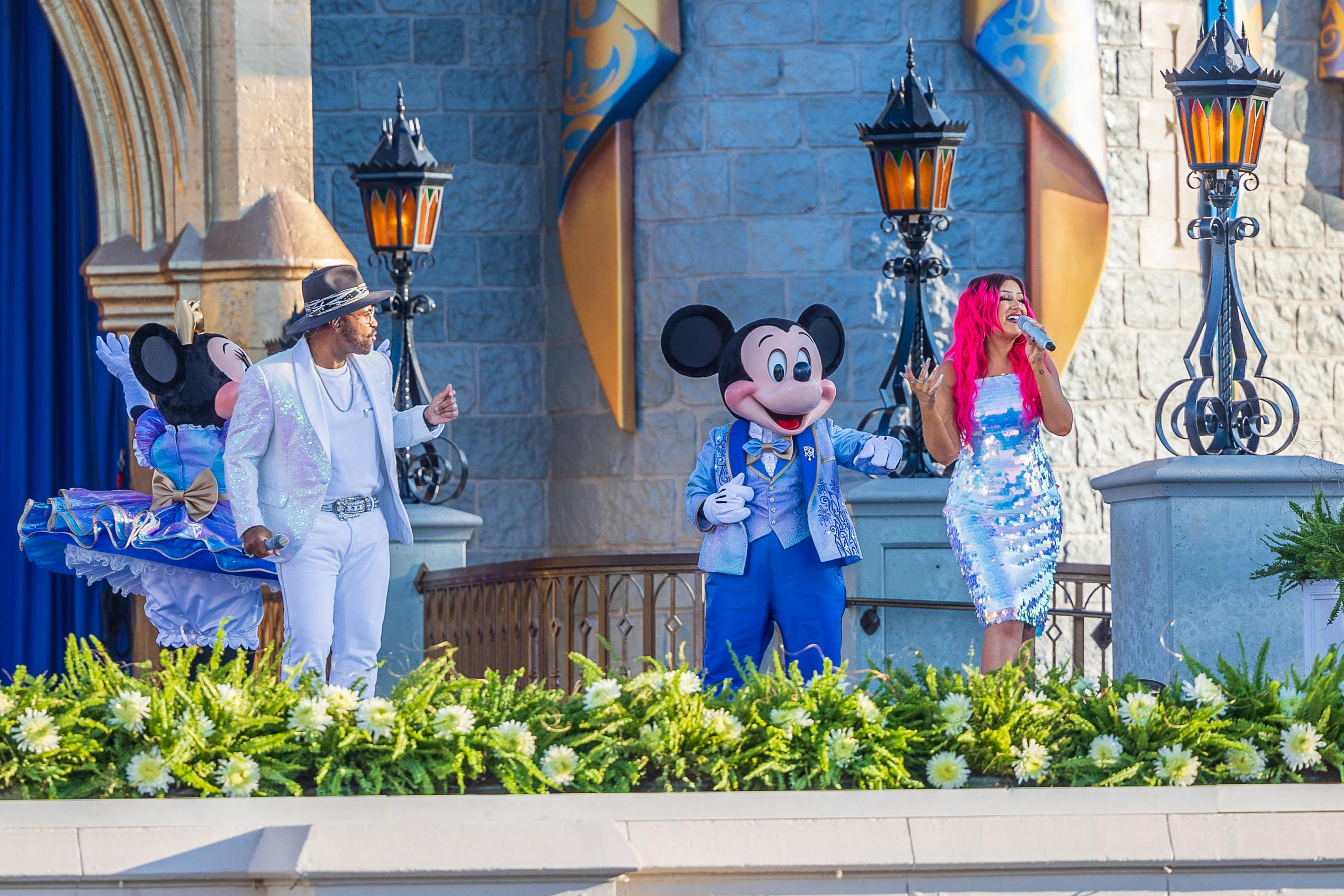 Philip Lawrence and Kayla Alvarez perform ''You are the Magic' at Cinderella Castle today as part of promotional shoot for Walt Disney World's 50th