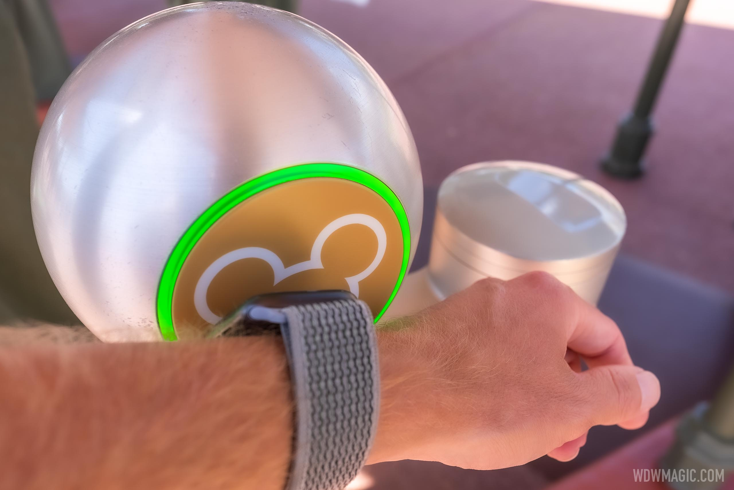 Apple Watch being used at the entrance to Magic Kingdom