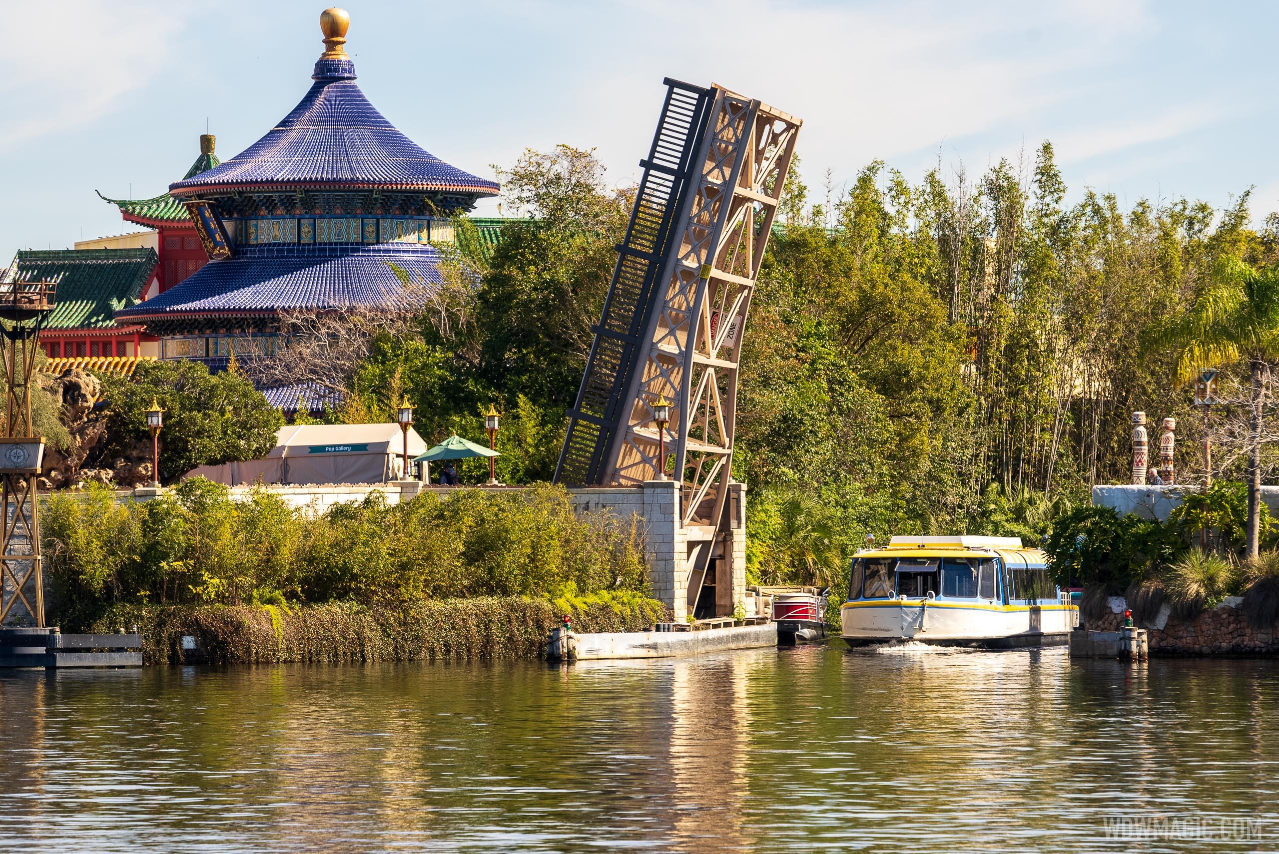 Friendship Boats passing through the promenade bridge onto World Showcase Lagoon