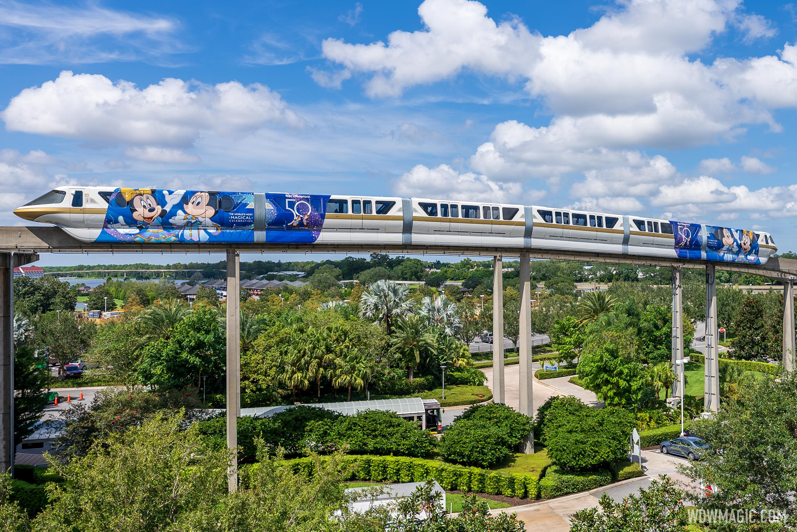 Monorail Gold wrapped with Walt Disney World 50th anniversary 'World's Most Magical Celebration' decal
