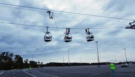 PHOTOS - Maintenance gondolas take to the Disney Skyliner cables